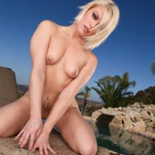 Blondy Ash Hollywood gets fucked outdoors by swimming pool