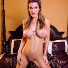 Kayla Paige strip out of her bra and panty set in bedroom