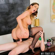 MILF Cherie DeVille bouncing on big young Dick